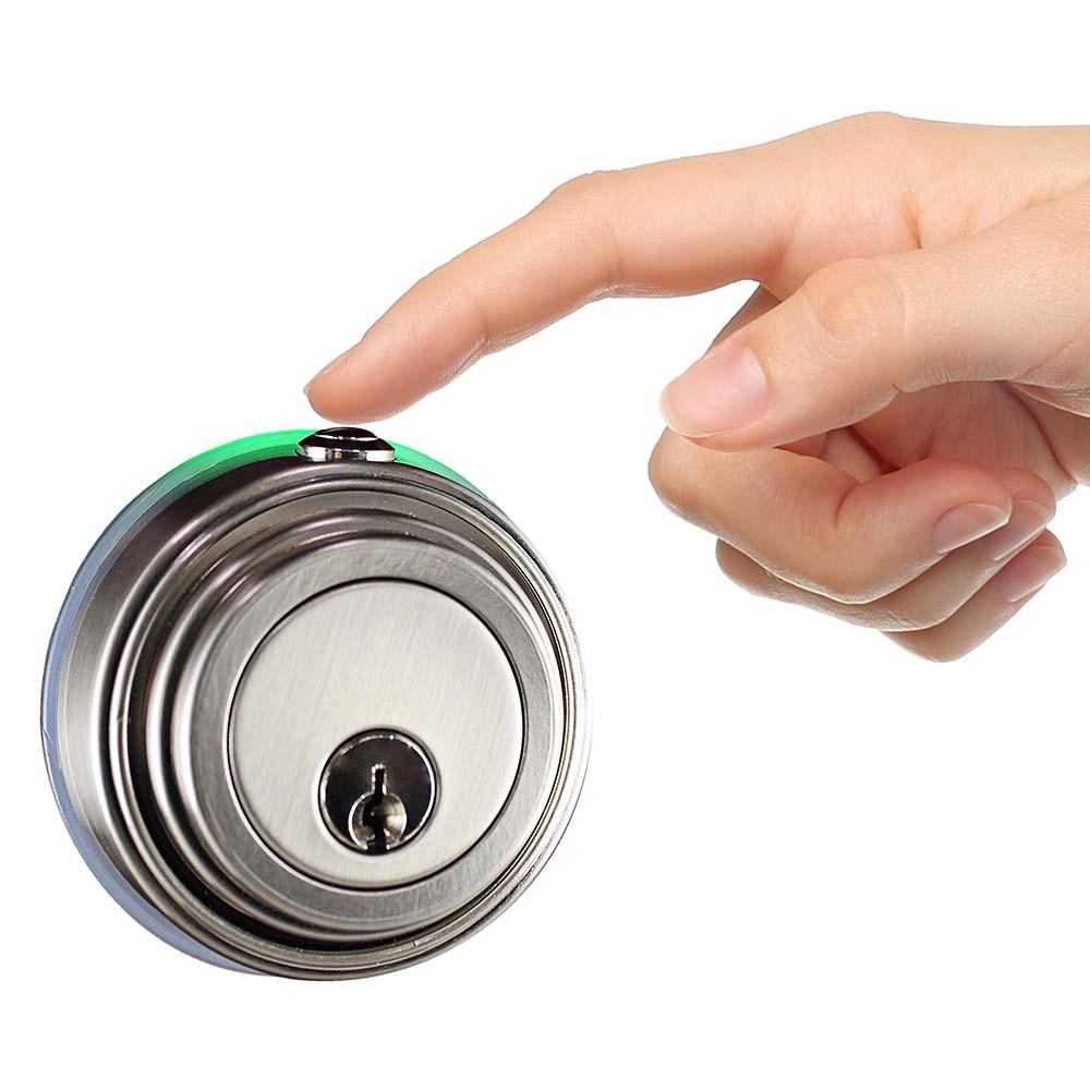 Touch release door lock mechanism