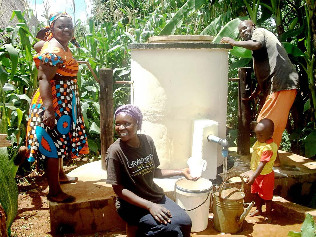 Villagers using one of AquAids Elephant Pumps